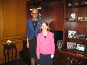 Linda Lane posed with Charlotte, a fourth grade girl advocating for Title IX equity