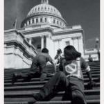 Disability advocates crawling up steps of the Capitol