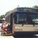 Image of a person using a wheelchair exiting the bus using a ramp.